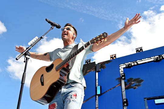 Country music recording artist Jake Owen performs before the 2019 Daytona 500.