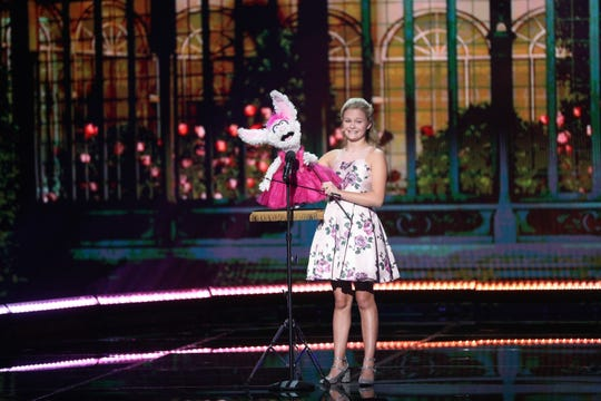 Ventriloquist Darci Lynne Farmer performs with Petunia during the final round of NBC's 'America's Got Talent: The Champions.'