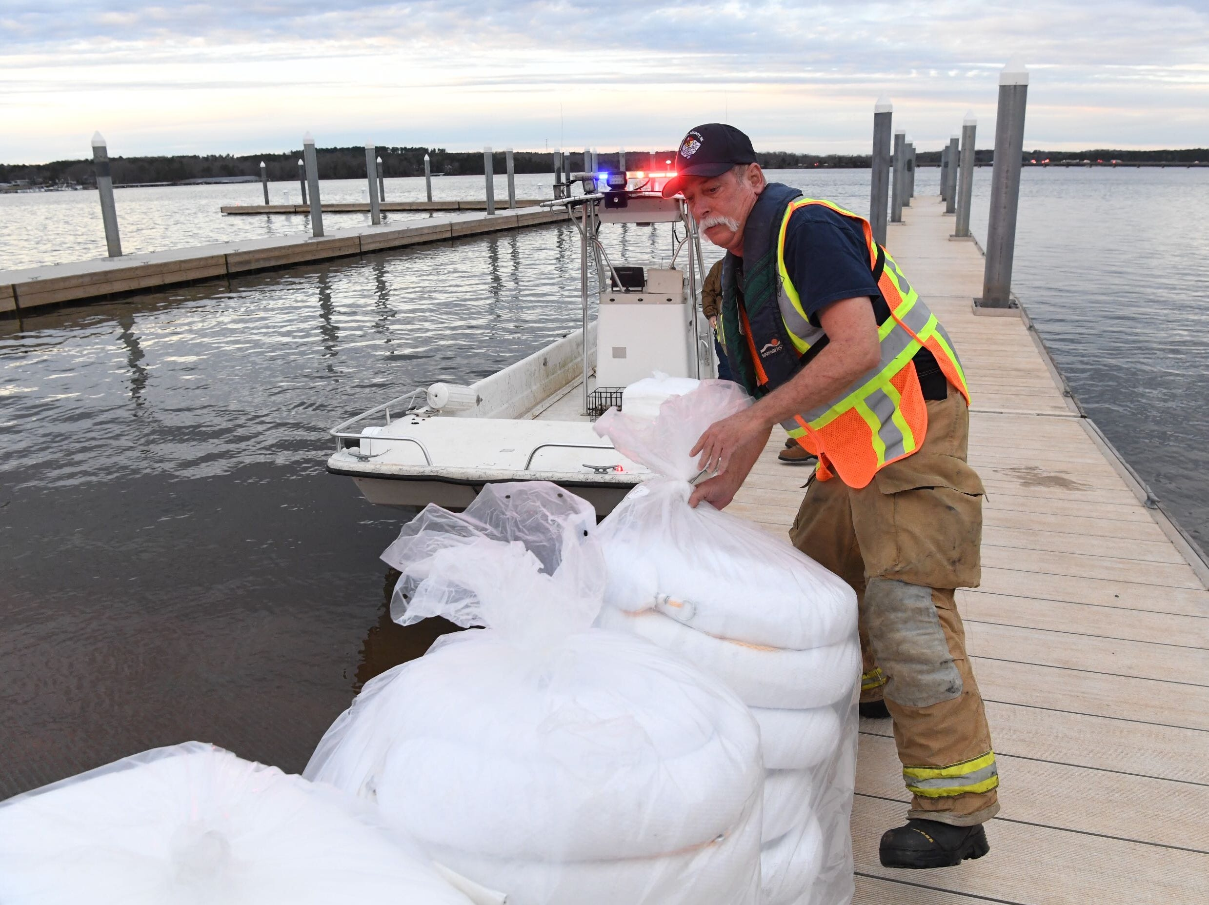 JT Tingen of Anderson County HAZMAT loads a boat with fuel absorbing pads at Green Pond Marina near the state highway 24 double bridges in Anderson Monday, Feb. 18, 2019.