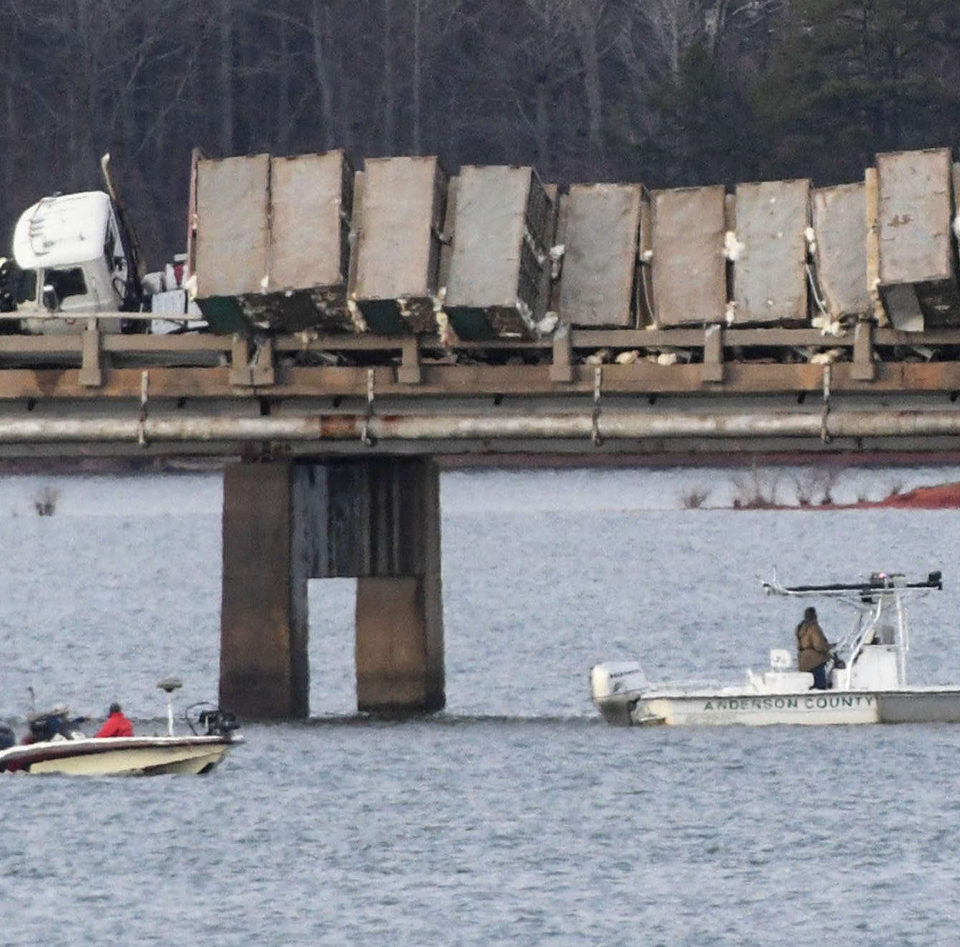 Person dies in wreck where truck hauling chickens was hanging over bridge on Lake Hartwell