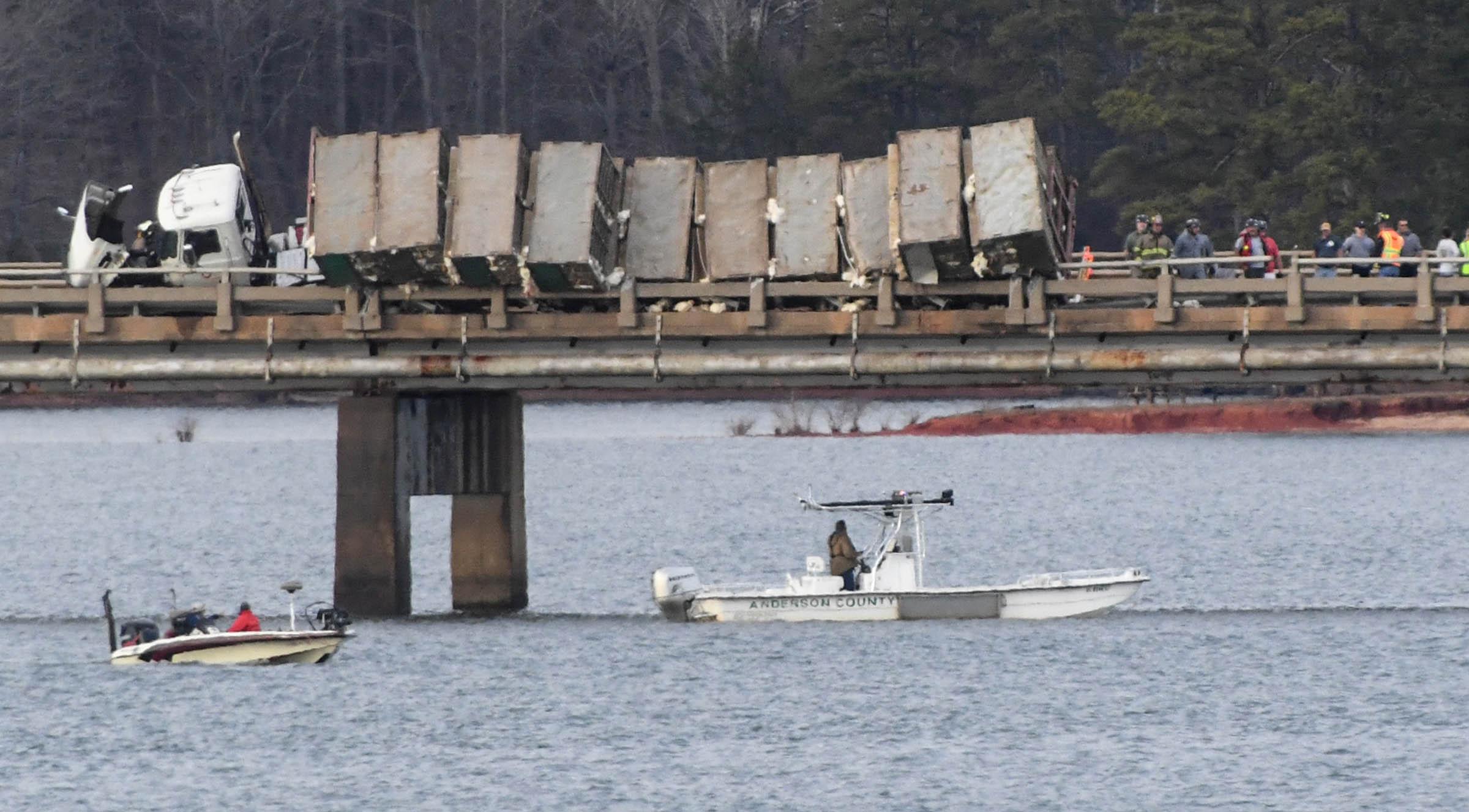 Person dies in wreck where chicken truck was hanging over bridge