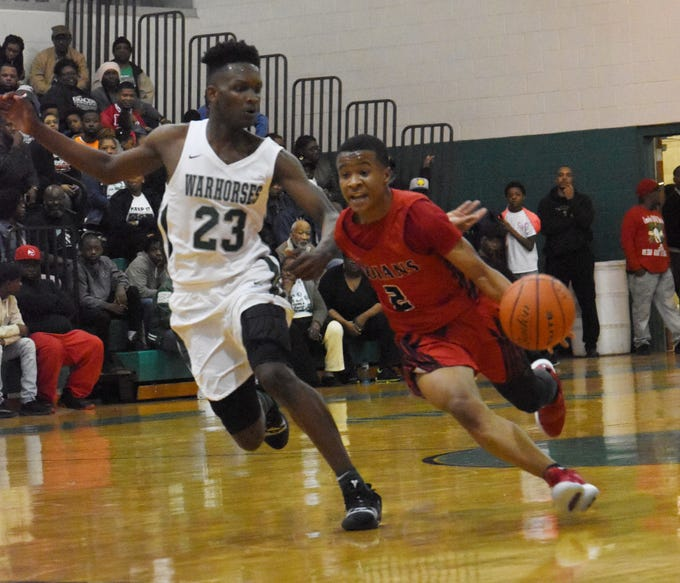 Tioga's Shemar Nash (2) dribbles past Peabody's Darius Smith Saturday, Feb. 16, 2019 in the Hall of Fame game. Peabody won 86-51.