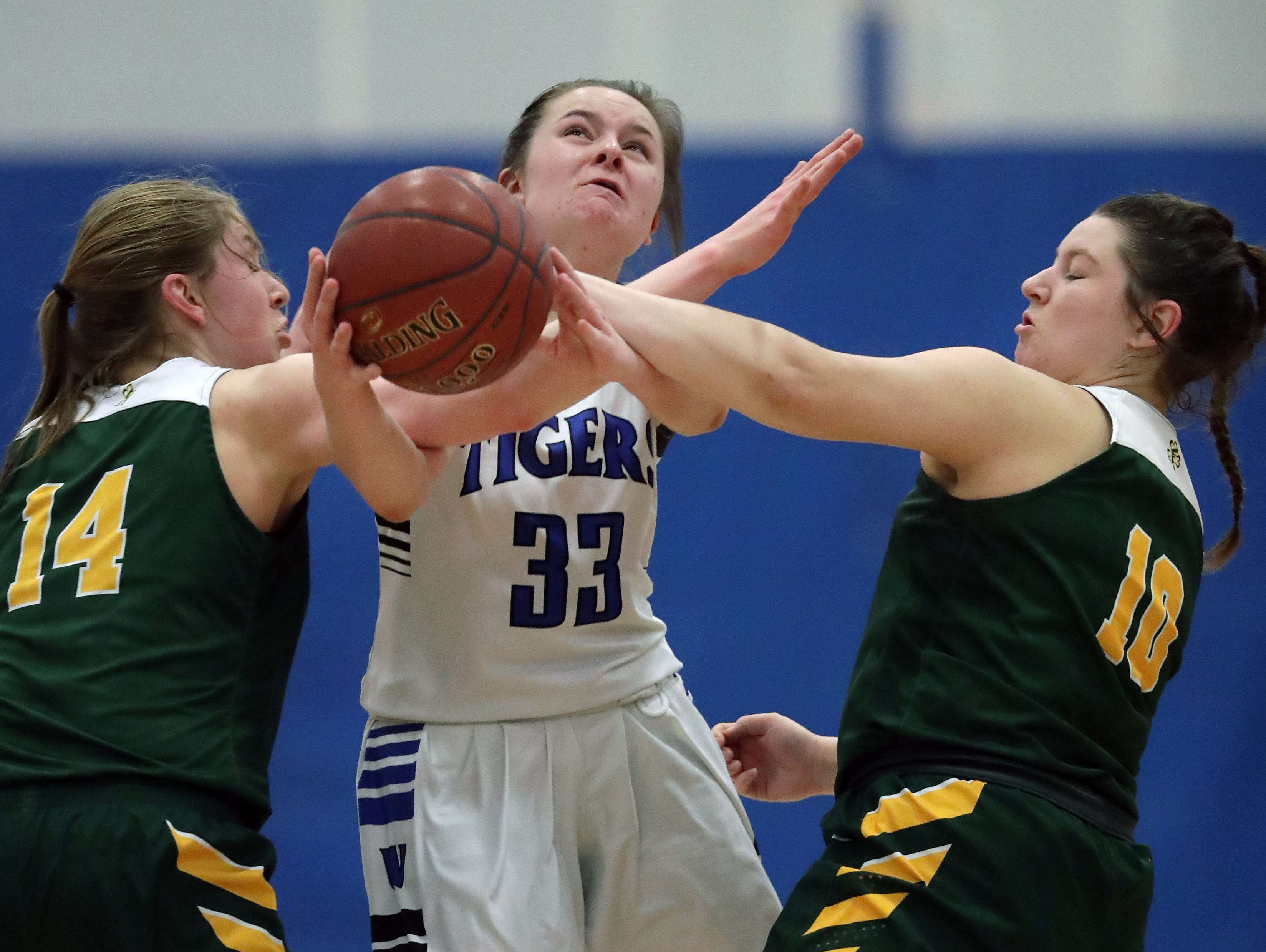Wrightstown High School's #33 Dayna Van Egeren against Freedom High School's #14 Karissa Wursrter and #10 Cameron Evers during their North Eastern Conference girls basketball game on Friday, February 15, 2019, in Wrightstown, Wis. Wm. Glasheen/USA TODAY NETWORK-Wisconsin.