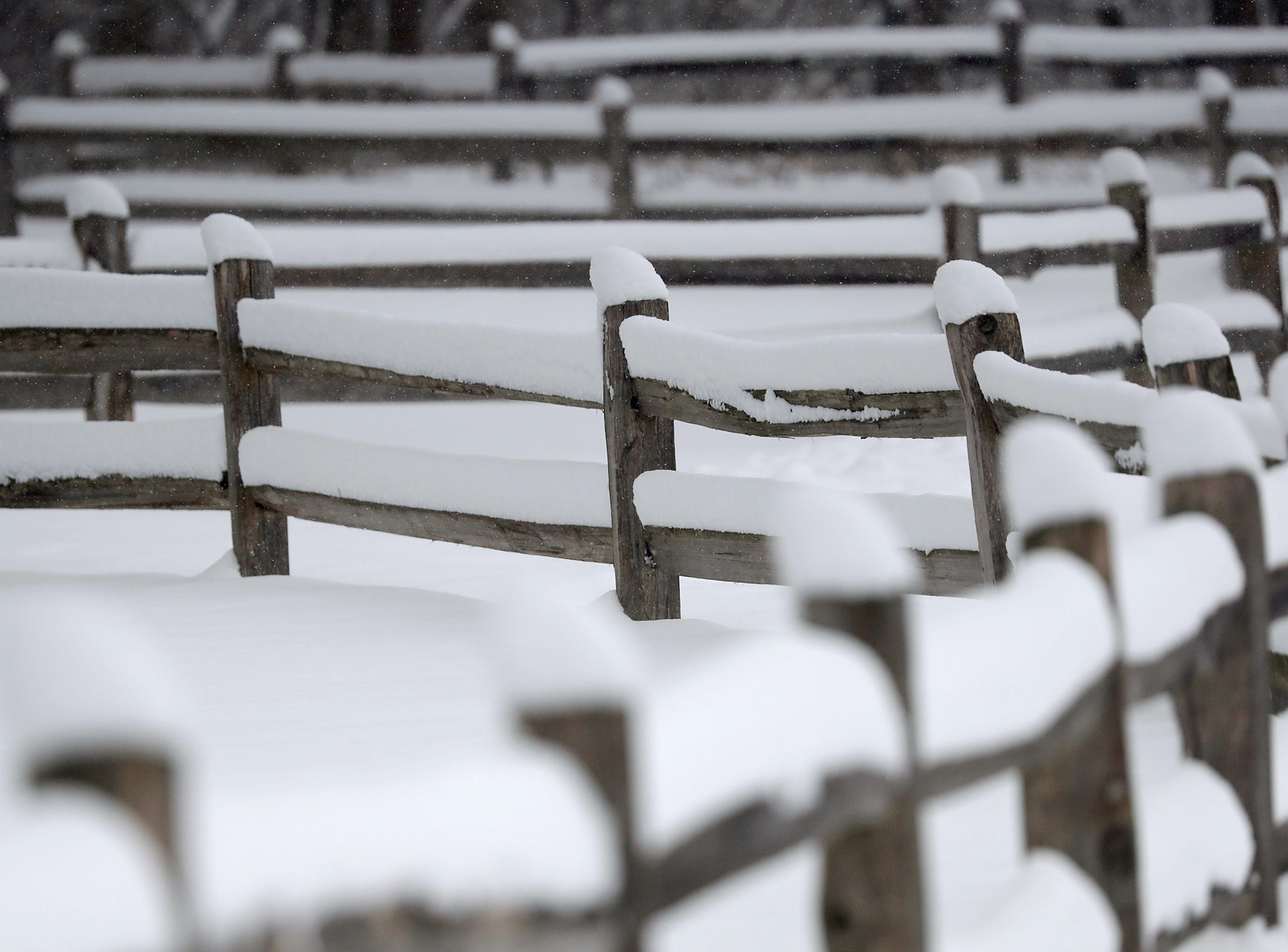 A fence line buried in snow on Tuesday, February 12, 2019, at the 1000 Islands Enviornmental Center in Kaukauna, Wis. The latest snow storm to move through the state dropped several inches of snow overnight, 6 to 12 inches are expcted by Tuesday evening.Wm. Glasheen/USA TODAY NETWORK-Wisconsin.