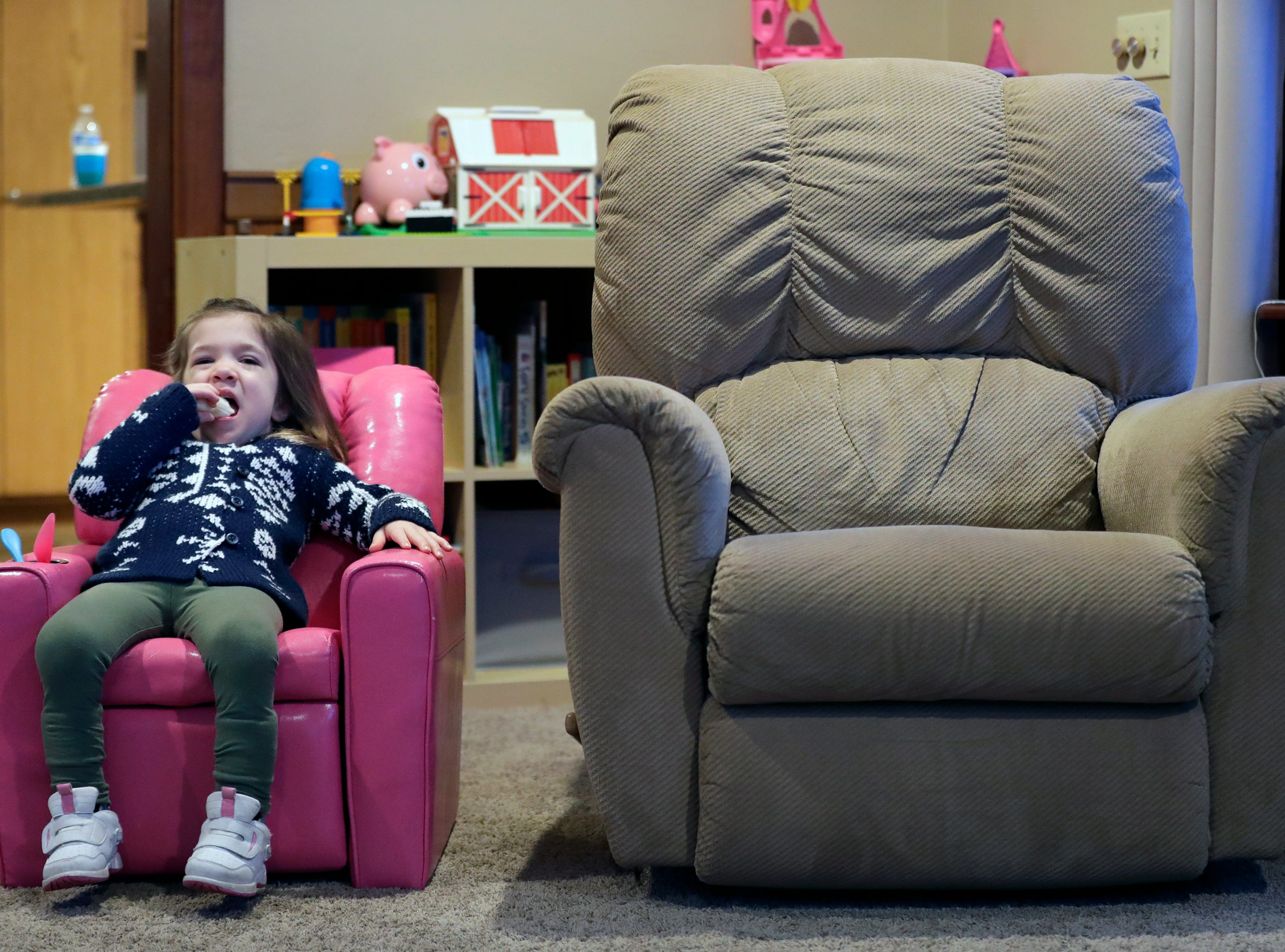 Avi Brennan, 4, enjoys a bananna as she relaxes before heading out for her first day of school Monday, January 7, 2019, at her home in Clayton, Wis. She is attending Washington School of Early Learning in Neenah.Dan Powers/USA TODAY NETWORK-Wisconsin