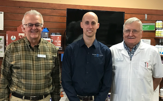 Appleton Hometown Pharmacy pharmacist and owner Tyler Wallenfang, center, is assisted by veteran pharmacists George Gosz, left, and Warren Doering, right.