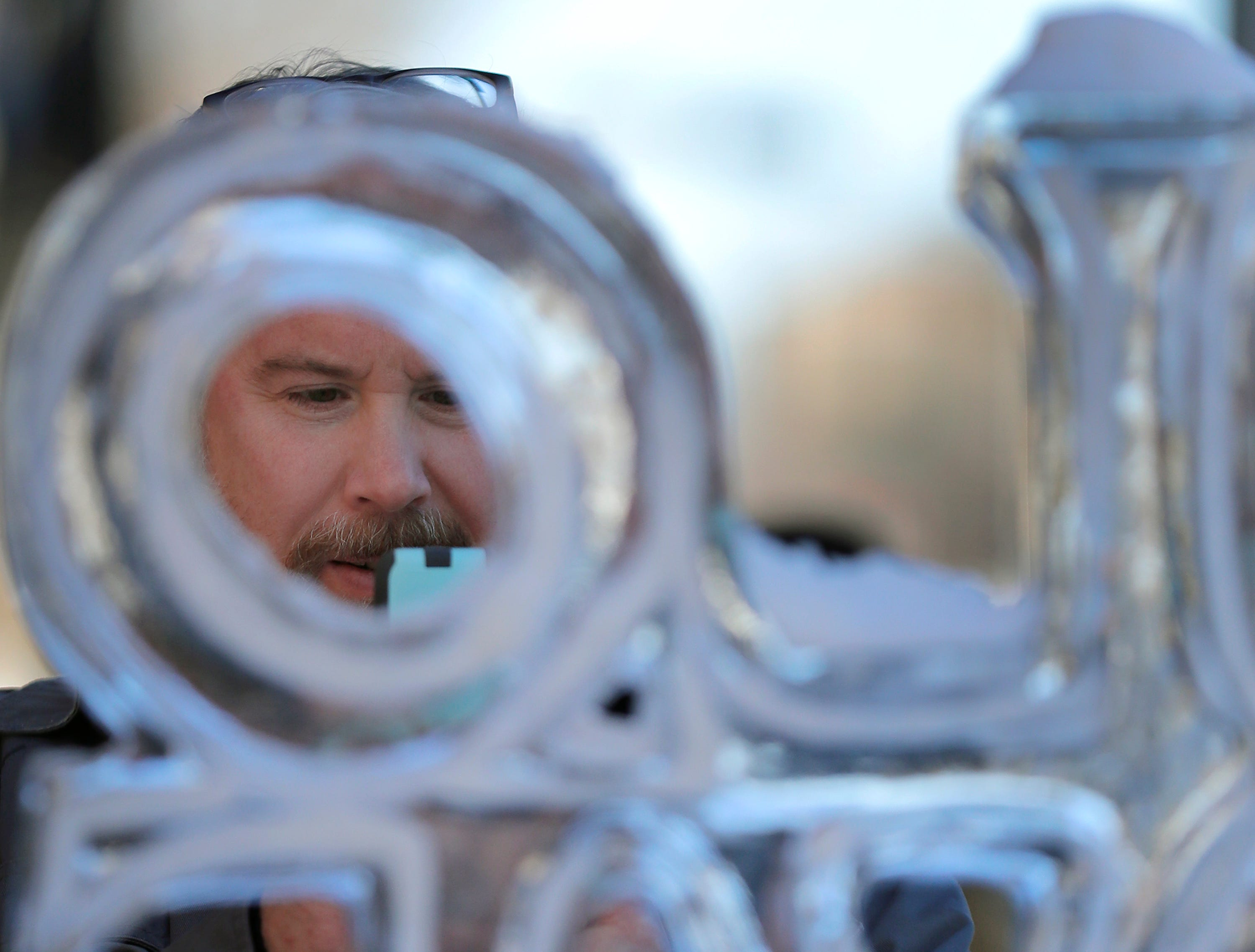 Will Keizer takes a picture of an ice sculpture on College Ave. on Wednesday, February 13, 2019, in Appleton, Wis. before he is transferred to prison. Wm. Glasheen/USA TODAY NETWORK-Wisconsin.