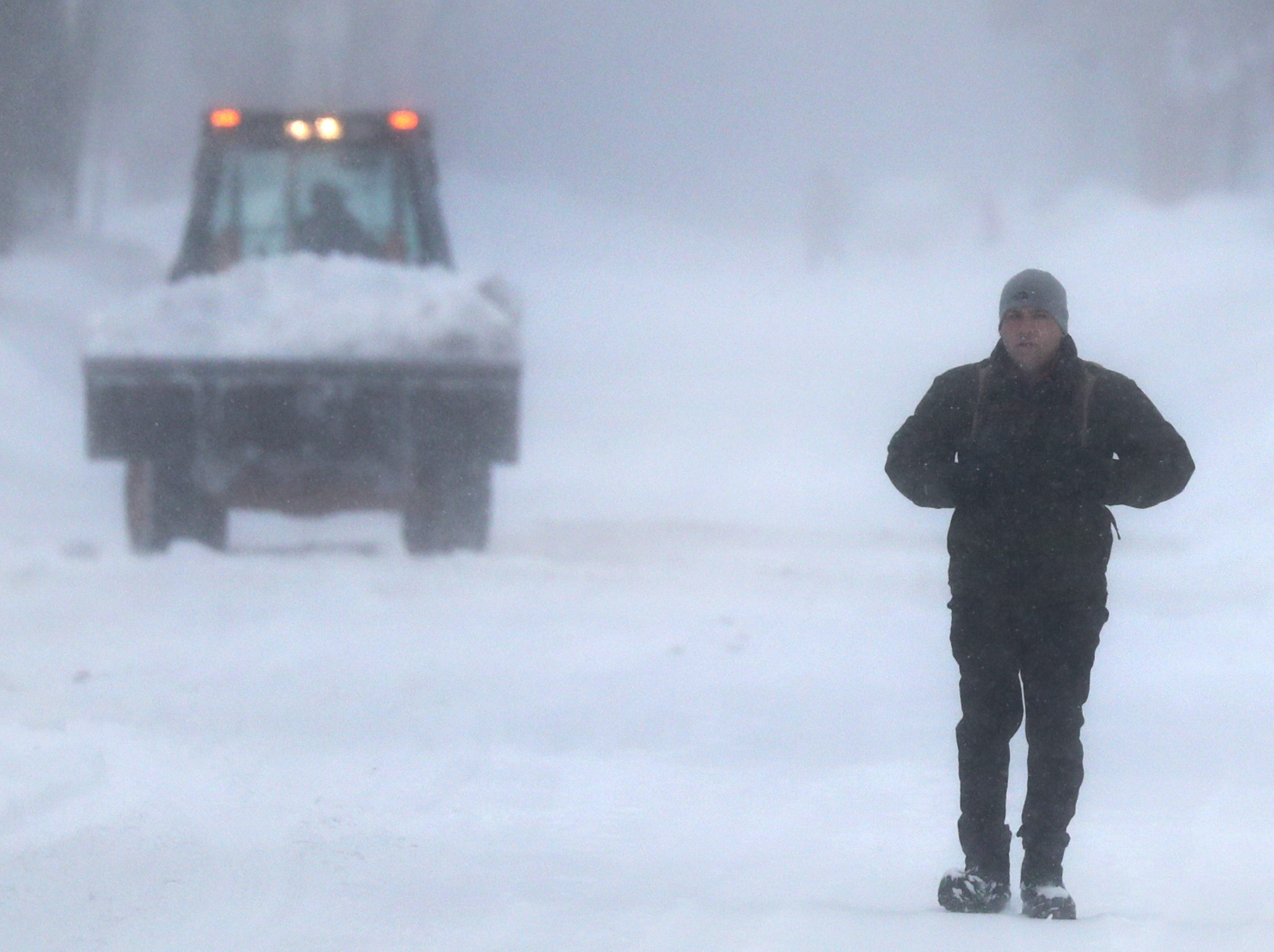 Brian Piasecki walks to work on Tuesday, February 12, 2019, in Appleton, Wis. The latest snow storm to move through the state dropped several inches of snow overnight, 6 to 12 inches are expcted by Tuesday evening.Wm. Glasheen/USA TODAY NETWORK-Wisconsin.
