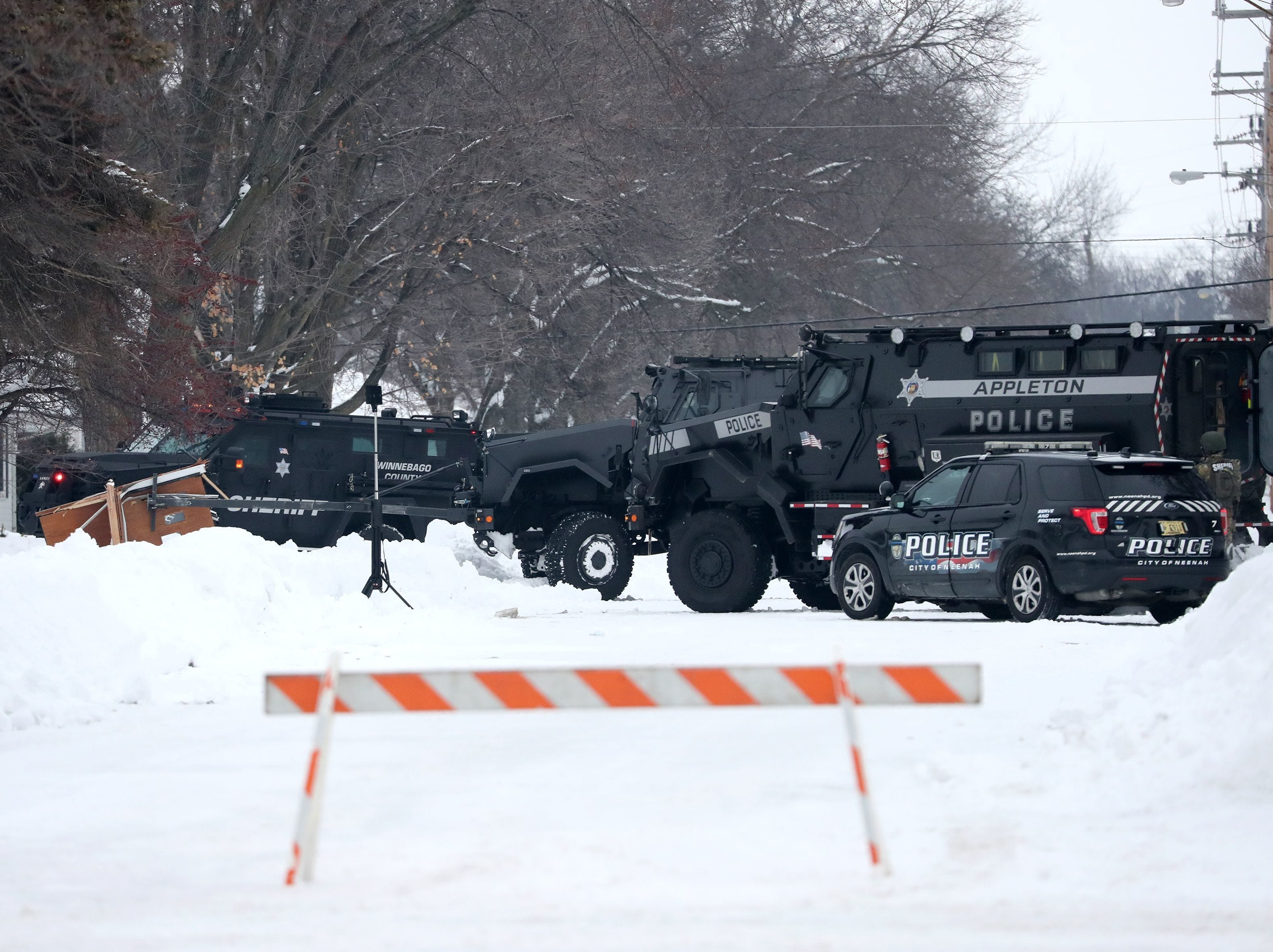 The heavy law enforcement presence during an active police incident in the 400 block of Quarry Lane Thursday, Feb. 14, 2019, in Neenah, Wis.