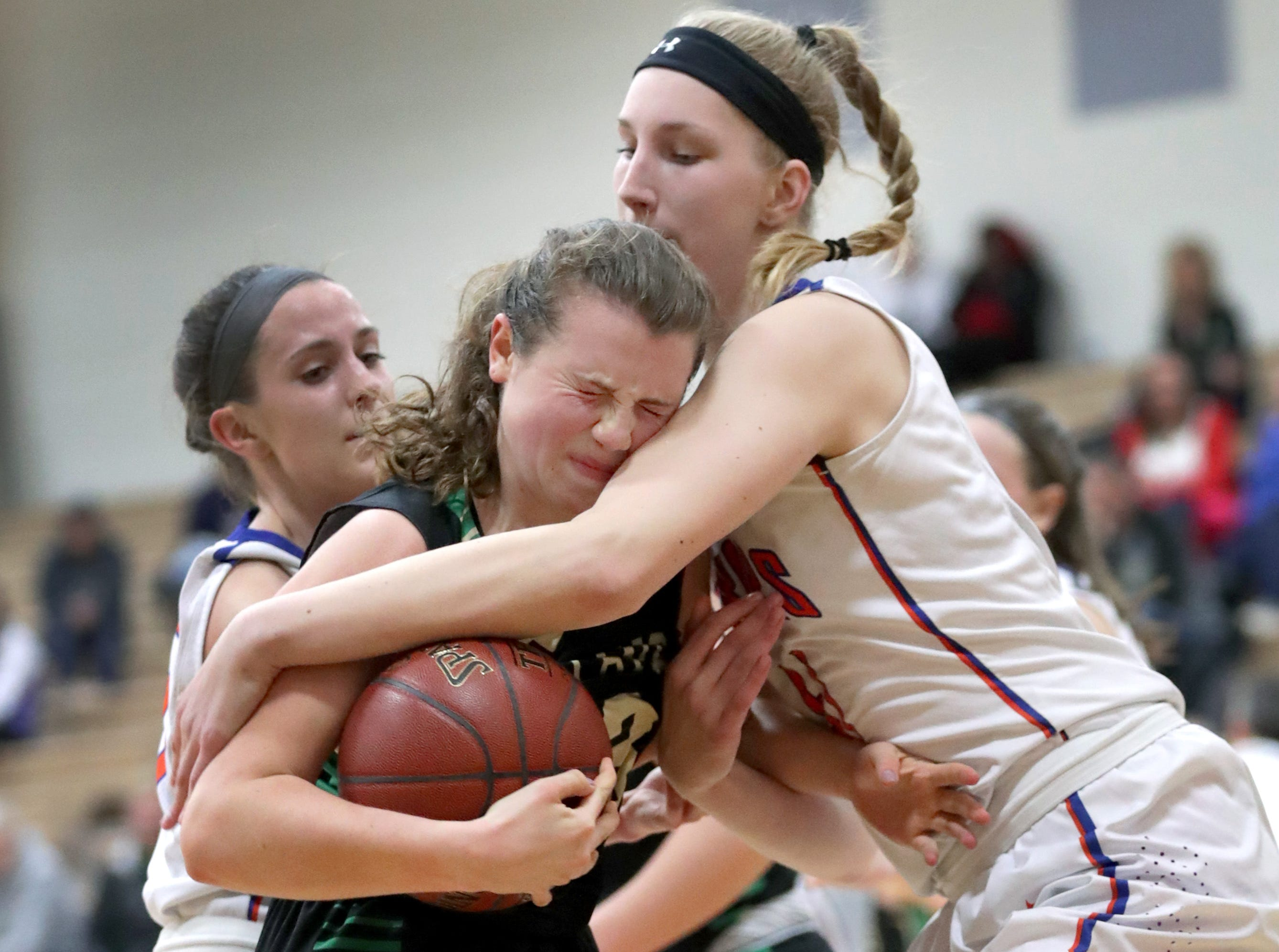 Appleton West High School's #41 Taylor Lauterbach, right, against Oshkosh North High School's #23 Elle Lieder during their girls baketball game on Thursday, February 14, 2019, in Appleton, Wis. Oshkosh defeated Appleton 51 to 46.Wm. Glasheen/USA TODAY NETWORK-Wisconsin.