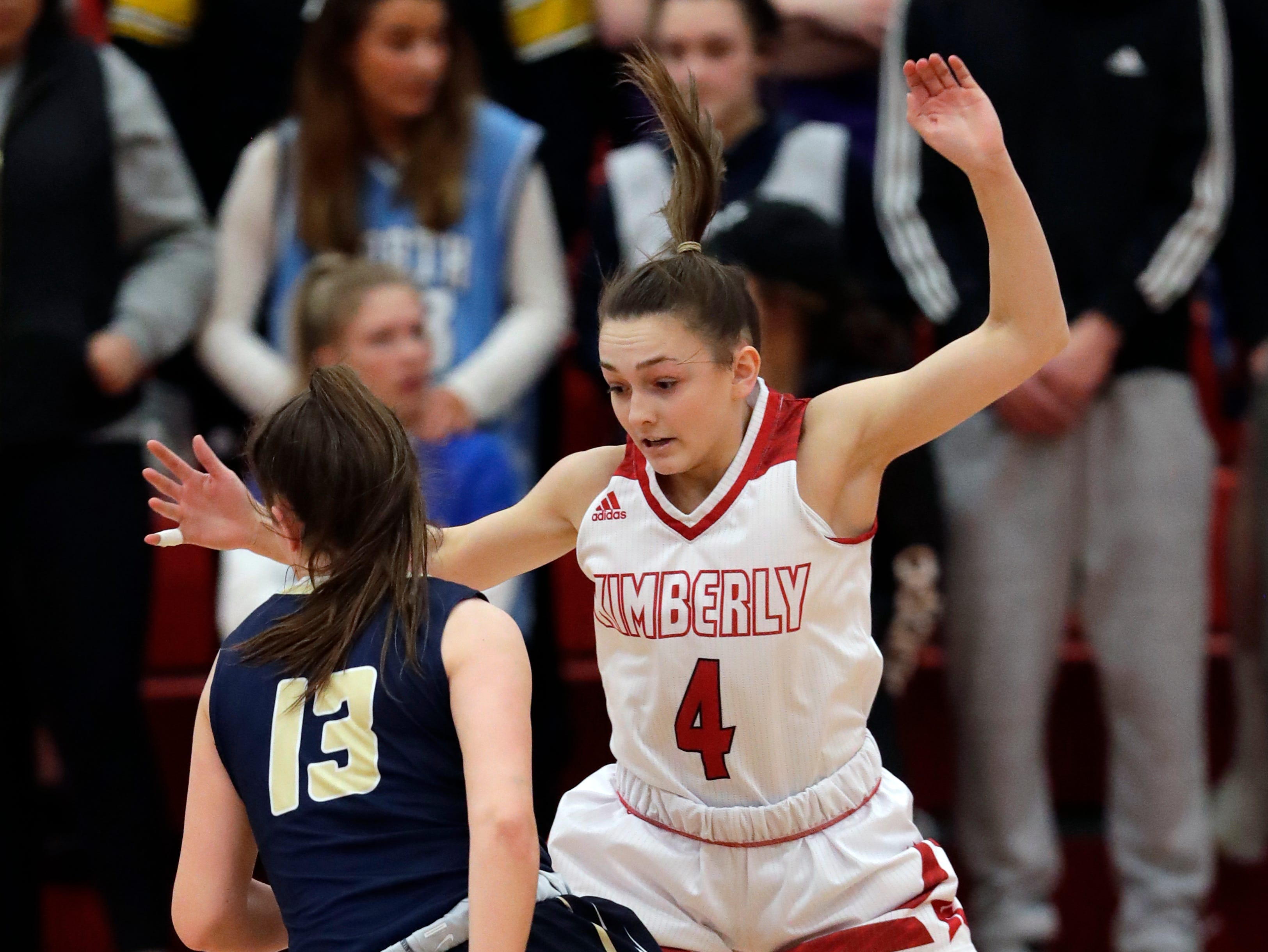 Kimberly High School's Hailey Rupnow (4) defends against Appleton North High School's Maggie Cartwright (13) during their girls basketball game Monday, February 11, 2019, in Kimberly, Wis. Dan Powers/USA TODAY NETWORK-Wisconsin