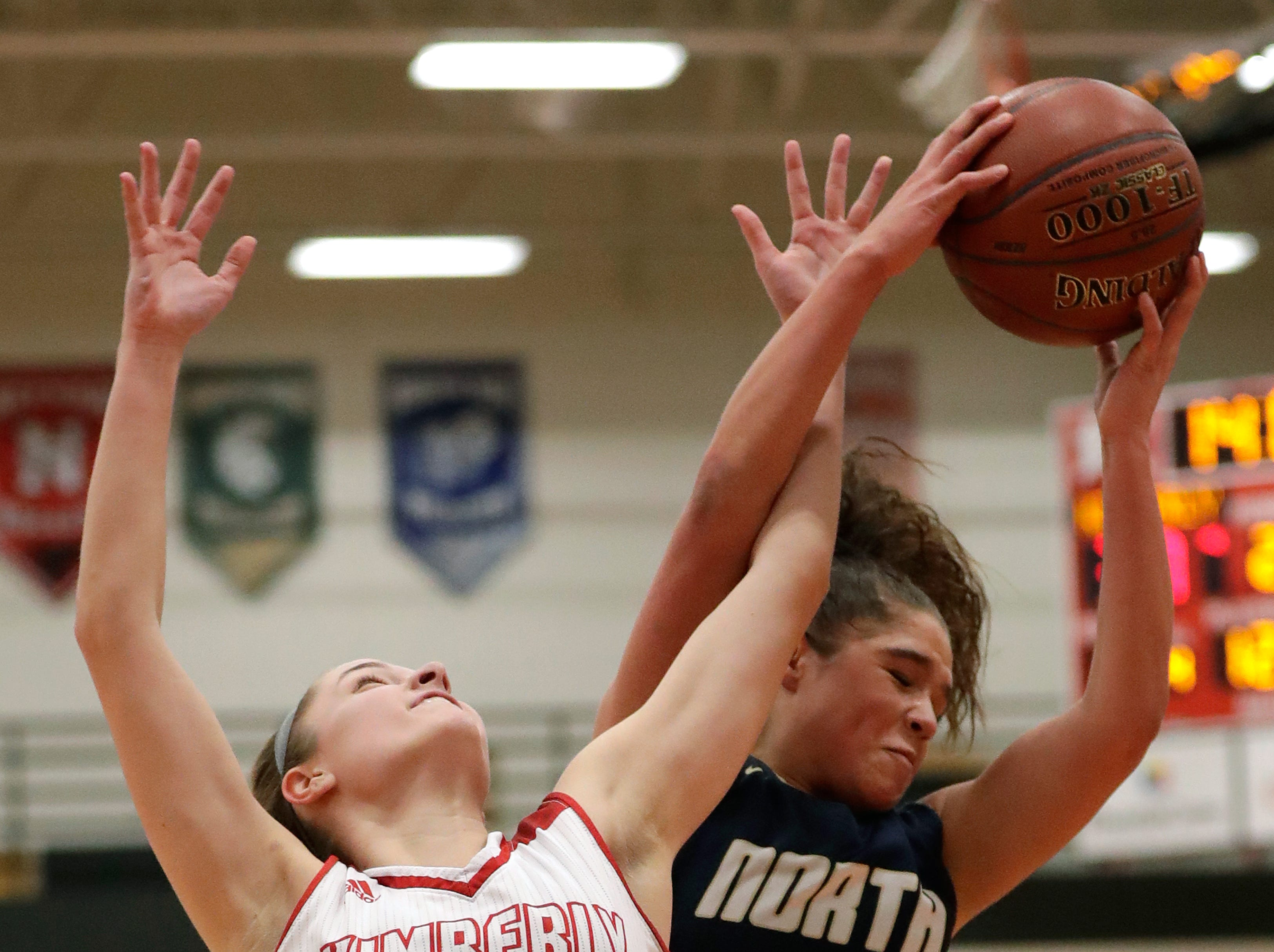Kimberly High School's Taylor Hietpas (14) battles for a rebound against Appleton North High School's Niki Van Wyk (5)  during their girls basketball game Monday, February 11, 2019, in Kimberly, Wis. Dan Powers/USA TODAY NETWORK-Wisconsin