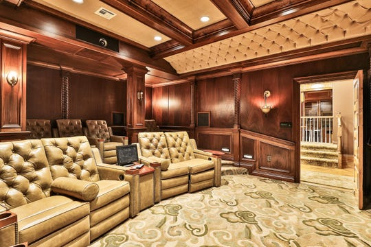 The lower level features a movie theater with amazing crown molding and beamed ceilings.