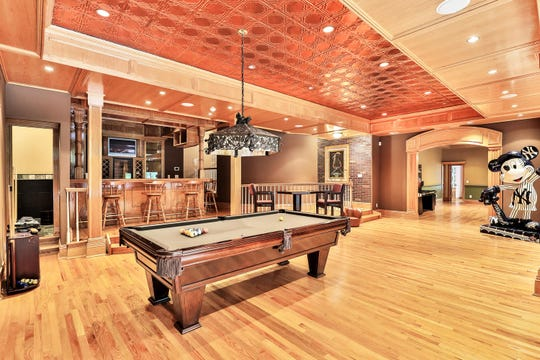The home offers an entertainment room with a bar and pool table.
