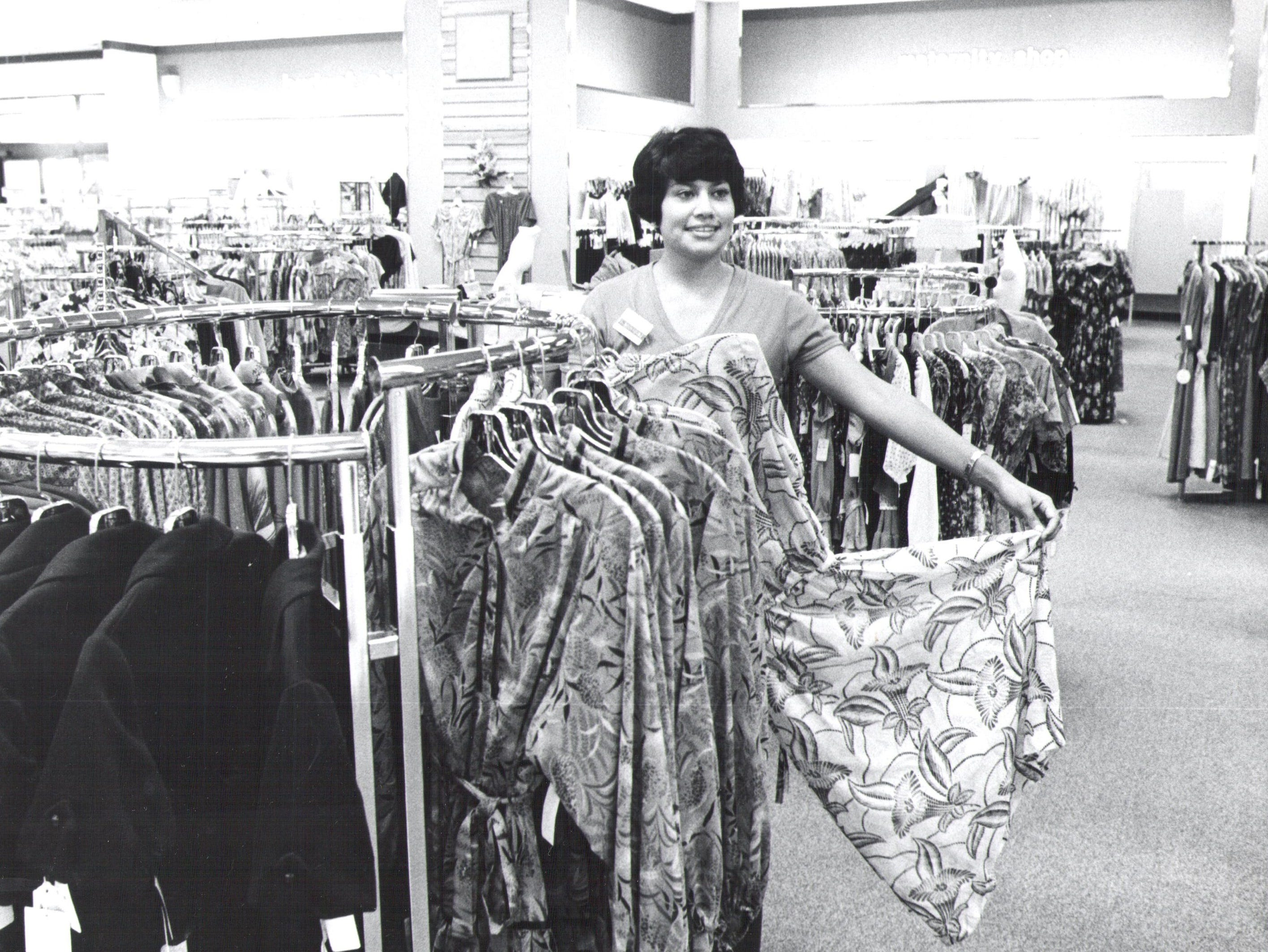 Ladies division manager Sally Rodriguez shows off clothing at the Sears store in the Mall of Abilene.