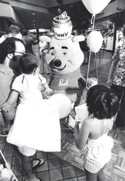 Winnie the Pooh makes an appearance at an open house for the Sears store in the Mall of Abilene.