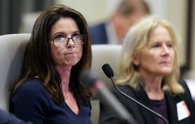 Executive director of the Board of Elections Kim Strach listens during the public evidentiary hearing on the 9th Congressional District investigation Feb. 18, 2019, at the North Carolina State Bar in Raleigh.