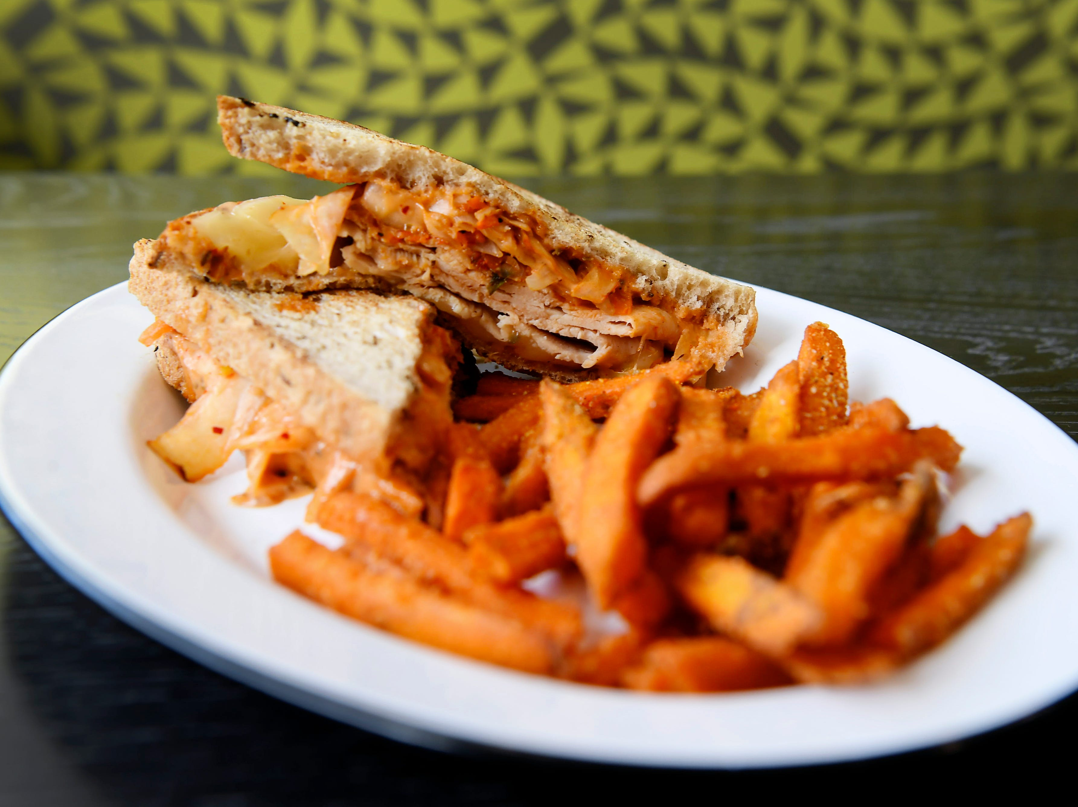A turkey kimchi reuben with sweet potato fries at Green Sage's new Merrimon location in North Asheville Feb. 14, 2019.