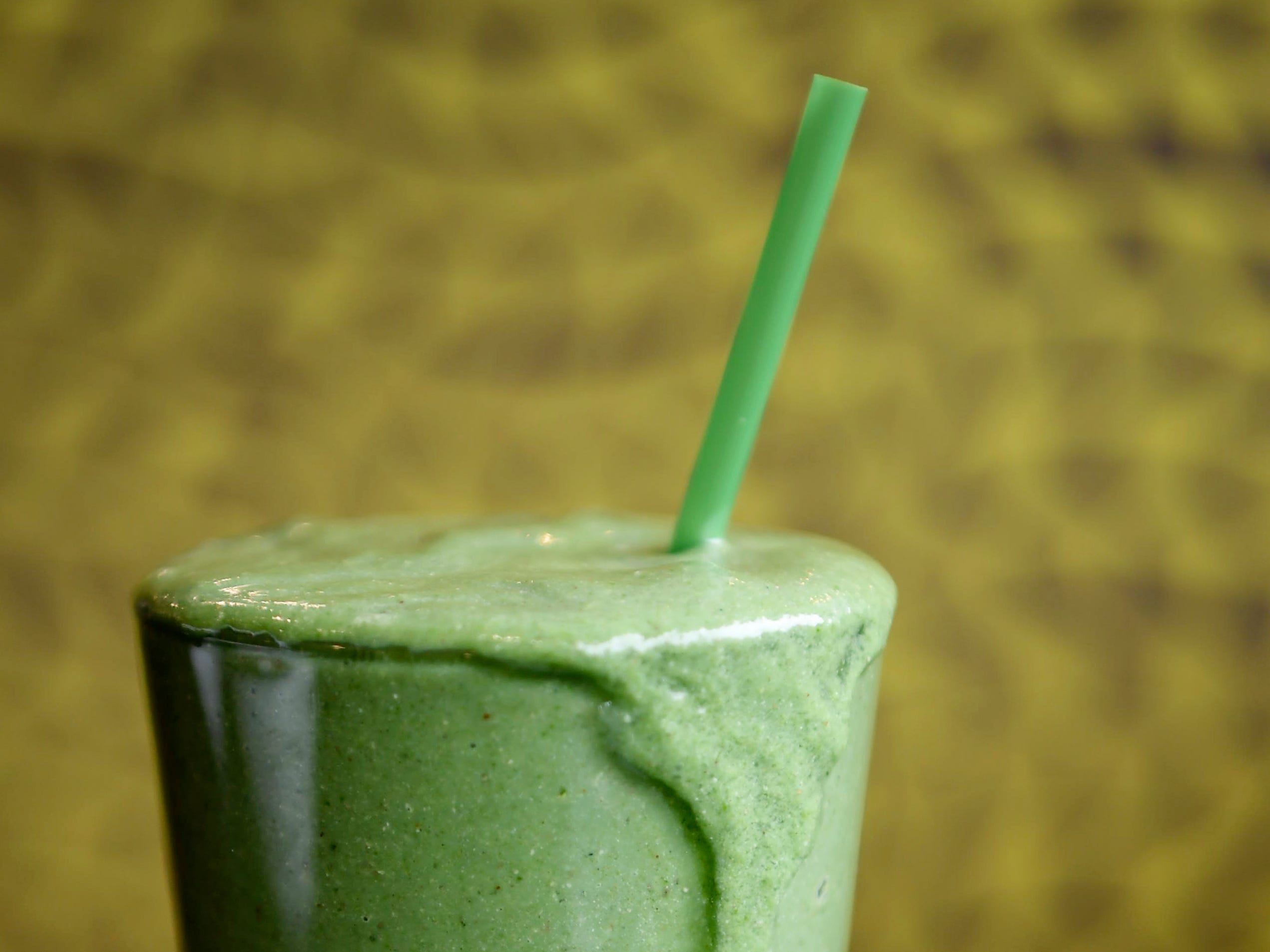 Green Sage's Green Day smoothie is made with banana, avocado, spinach, kale, dates, almond butter,chia seeds, spirulina, and almond milk.