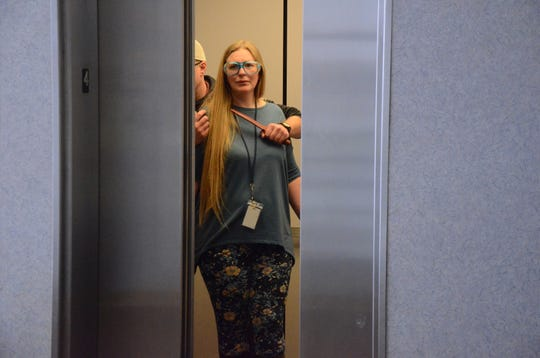 Nora Geiger from the Calhoun County Prosecutor's office played the role of a hostage during training on possible courthouse violence on Monday.