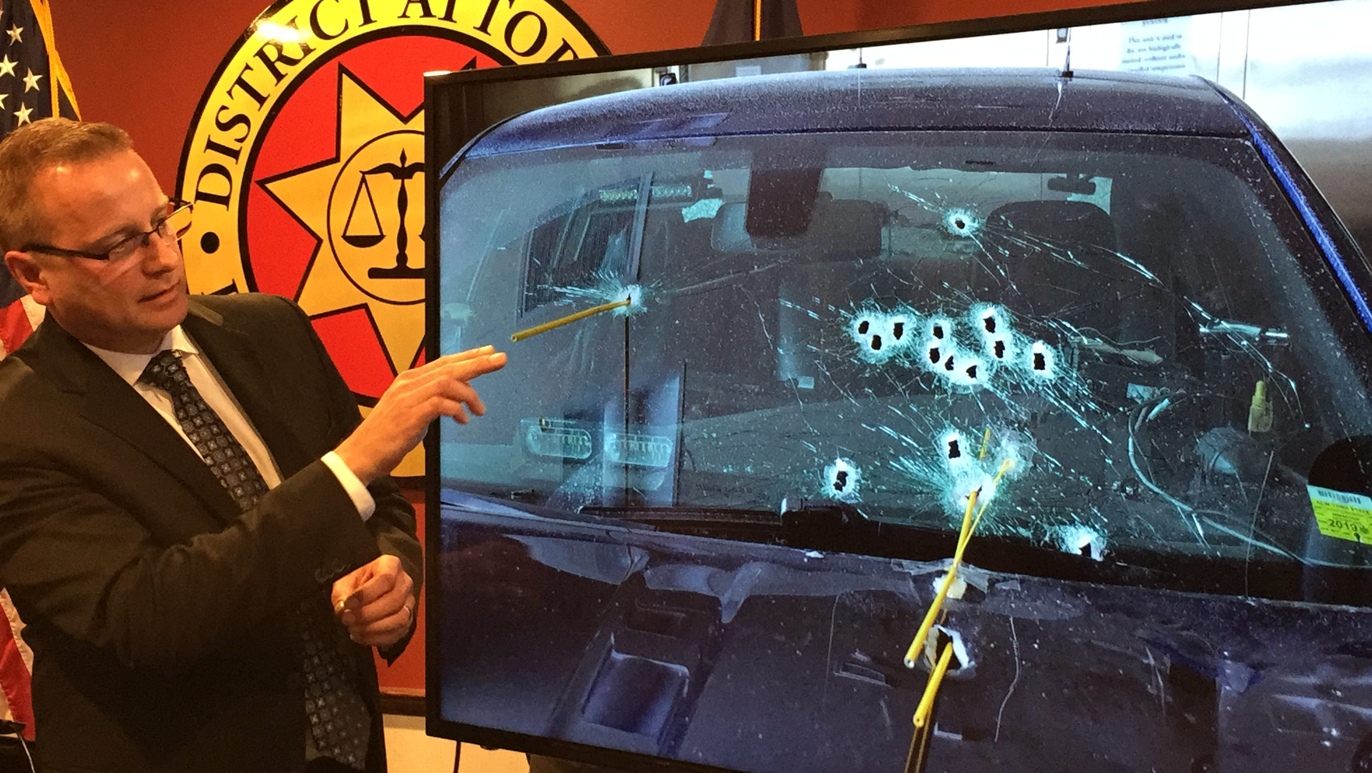 Broome County District Attorney Steve Cornwell shows the path of bullets fired by Nicholas Philhower at New York State Trooper Timothy Conklin.