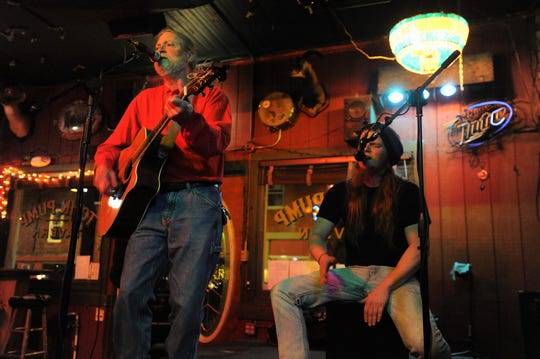 David Bryan opens up open mic night at the Town Pump Tavern on Feb. 16.