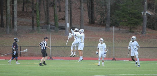 Players for the Cavaliers celebrate after scoring a goal on Brevard in the opening game of the 2019 season.