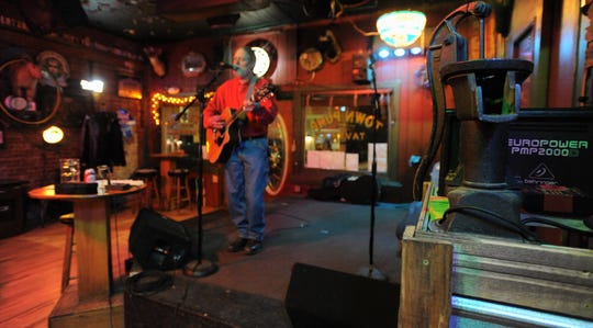 David Bryan takes the stage at the Town Pump Tavern on a Wednesday to kick off open mic night.