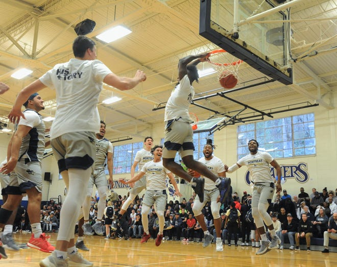 Senior Alonzo Mobley throws down a reverse slam in front of his teammates as the Montreat Cavaliers prepared to take on the Union Bulldogs on Feb. 16.