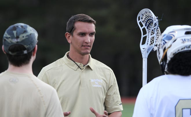 Montreat College lacrosse coach Ethan Kamholtz talks with his players on the sideline during a 17-10 loss to Brevard College at Howard Fisher Memorial Field on Feb. 6.