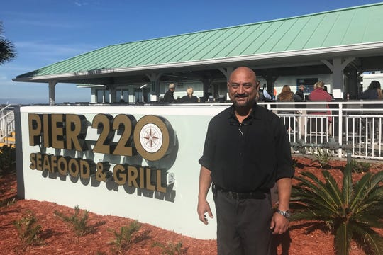 Titusville neuruolgist Sachin R. Shenoy opened Pier 220 Seafood & Grill in Titusville on Dec. 31.