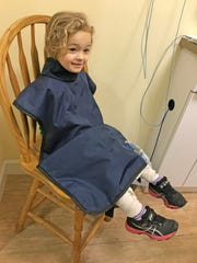Isabella gets ready to have her teeth X-rayed at Sunshine Smiles Pediatric Dentistry in Suntree.