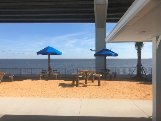 Pier 220 has lots of outdoor seating along Titusville's Veterans Memorial Fishing Pier.