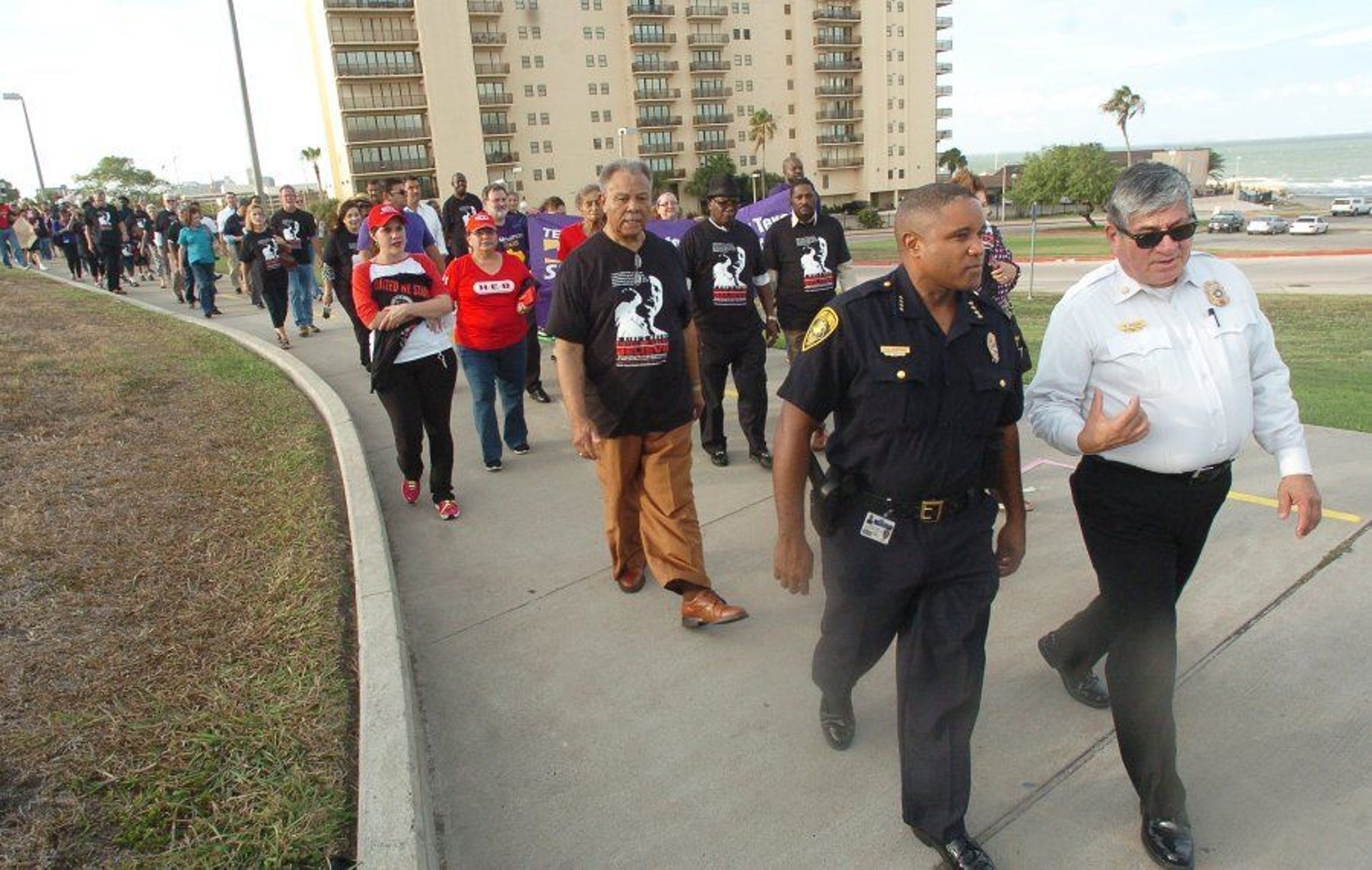 Corpus Christi Police Chief Floyd Simpson (left) and Corpus Christi Fire Chief Robert Rocha walk in the United We Stand march commemorating Dr. Martin Luther King's 'I Have A Dream' speech. Simpson was the city's first black police chief. He died in 2015.
