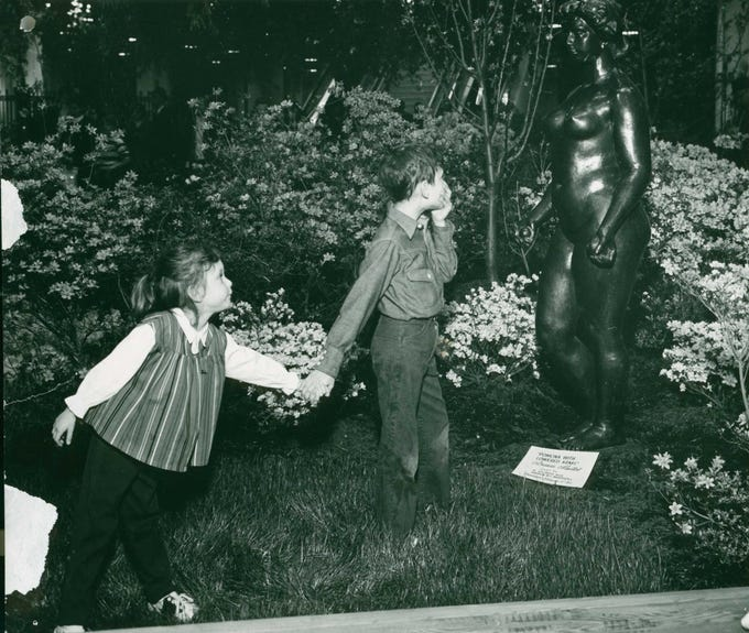 A young boy seems scandalized by a sculpture at the 1956 Philadelphia Flower Show.