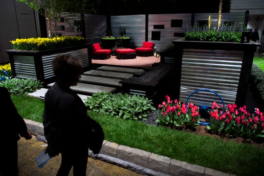 Guests browse extravagant patio and garden setups on display inside the Philadelphia Flower Show Thursday, March 16, 2017 at the Convention Center in Philadelphia.