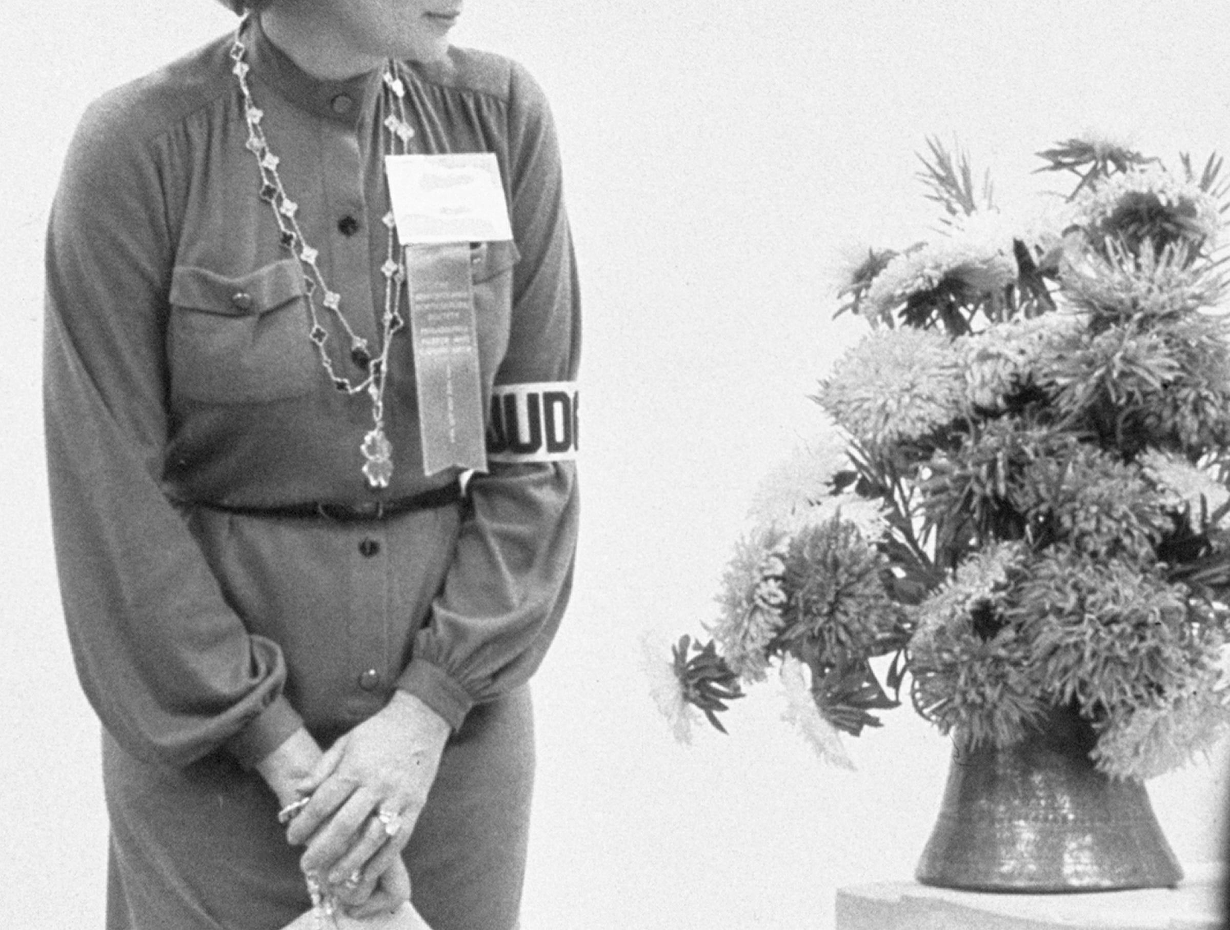 Princess Grace judges an exhibit at the Philadelphia Flower show in 1976.