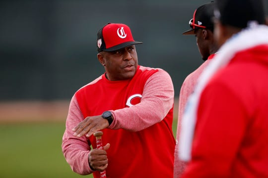 Cincinnati Reds coach Billy Hatcher works with outfielders during practice at the Cincinnati Reds spring training facility in Goodyear, Ariz., on Monday, Feb. 18, 2019.