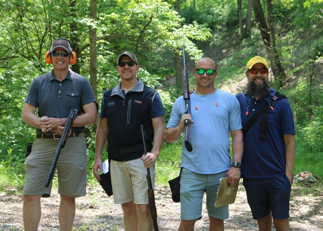 From left: Shooters Mike Castrucci, Indian Hill, Bill Rempe, Loveland, Joel Hern, Terrace Park, and Dr. Shawn Carson, Indian Hill, take a break on the course at the 2018 Stepping Stones Sporting Clays Tournament.