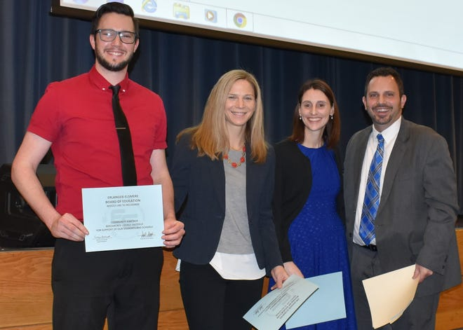 Corey Hatfield of Beech Acres, Sarah Zawaly of Children, Inc., Jaimi Cabrera of Beech Acres and Josh Jackson of Miles school, at a recognition event celebrating the success of The Character Effect at the school.