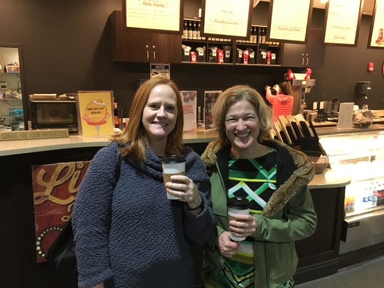 Melissa Knapke, left,  of Amberley Village, and Dawn Freudenberg of Pleasant Ridge at the Cosmic Coffee coffeehouse on the main floor of the AMC Theatres building at Newport on the Levee.