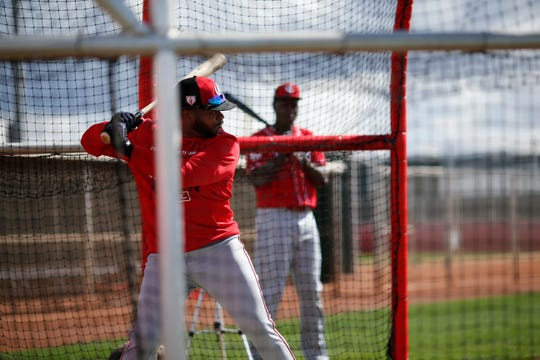 Cincinnati Reds right fielder Phillip Ervin (6) takes reps at the plate during practice at the Cincinnati Reds spring training facility in Goodyear, Ariz., on Monday, Feb. 18, 2019.