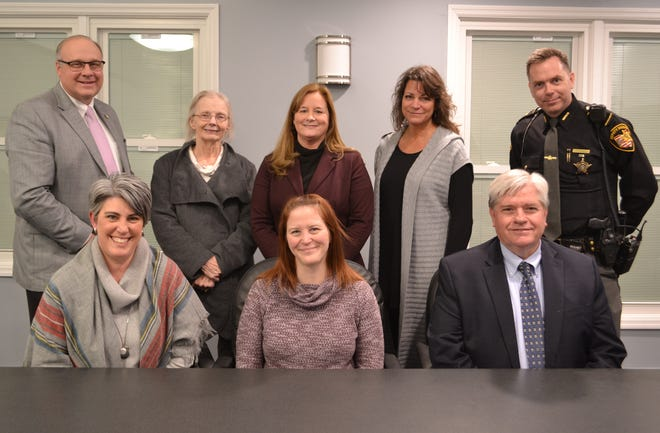 Front row (from left) are: Laurie Lupinetti, Megan Trowbridge, and Jamie Scott. Back row (left to right): Tom Harris, Debbie Delp, Megan Manuel, Cindy Maloney and Barry Riley.