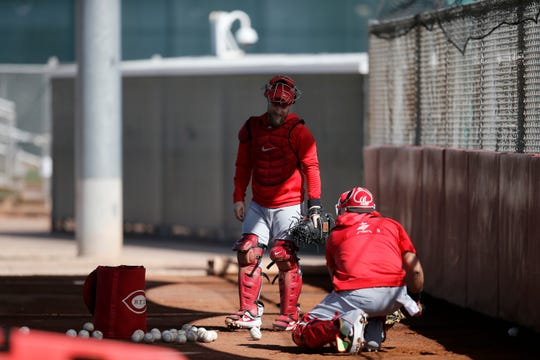Cincinnati Reds catcher Tucker Barnhart (16) works with catchers at the Cincinnati Reds spring training facility in Goodyear, Ariz., on Monday, Feb. 18, 2019.