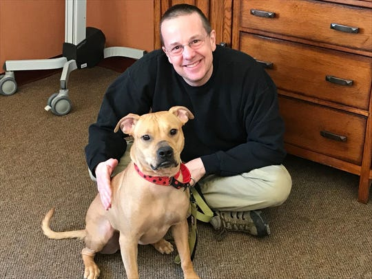 Bob Hucke and Emerald, a year after the pit bull mix was rescued from being found tied up by her snout. She was adopted by Hucke and his wife, Beth, a board member of Outcast Rescue.