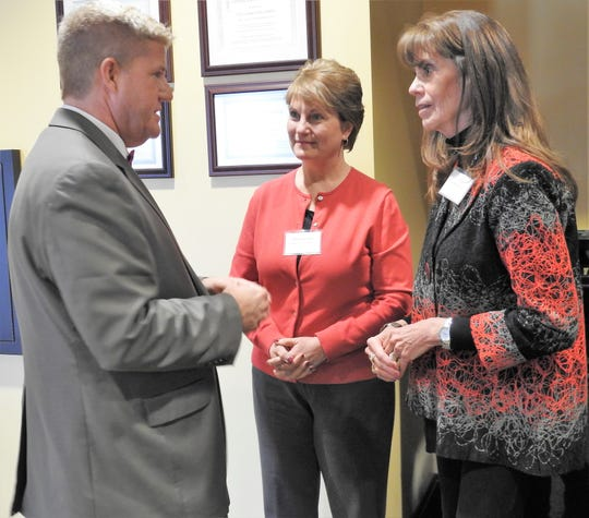 John Berry, new president of Central Ohio Technical College, speaks with Rhoda Crown of Coshocton Grain Co. and Mary Ellen Given of the Roscoe Village Foundation at a recent meet and greet on the Coshocton Campus.