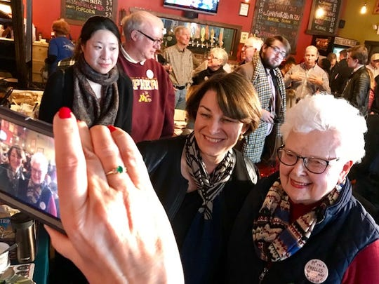 Sen. Amy Klobuchar posed for a photo with campaign volunteer and Knoxville resident Phyllis Weeks, 79, at Peace Tree Brewing Company.