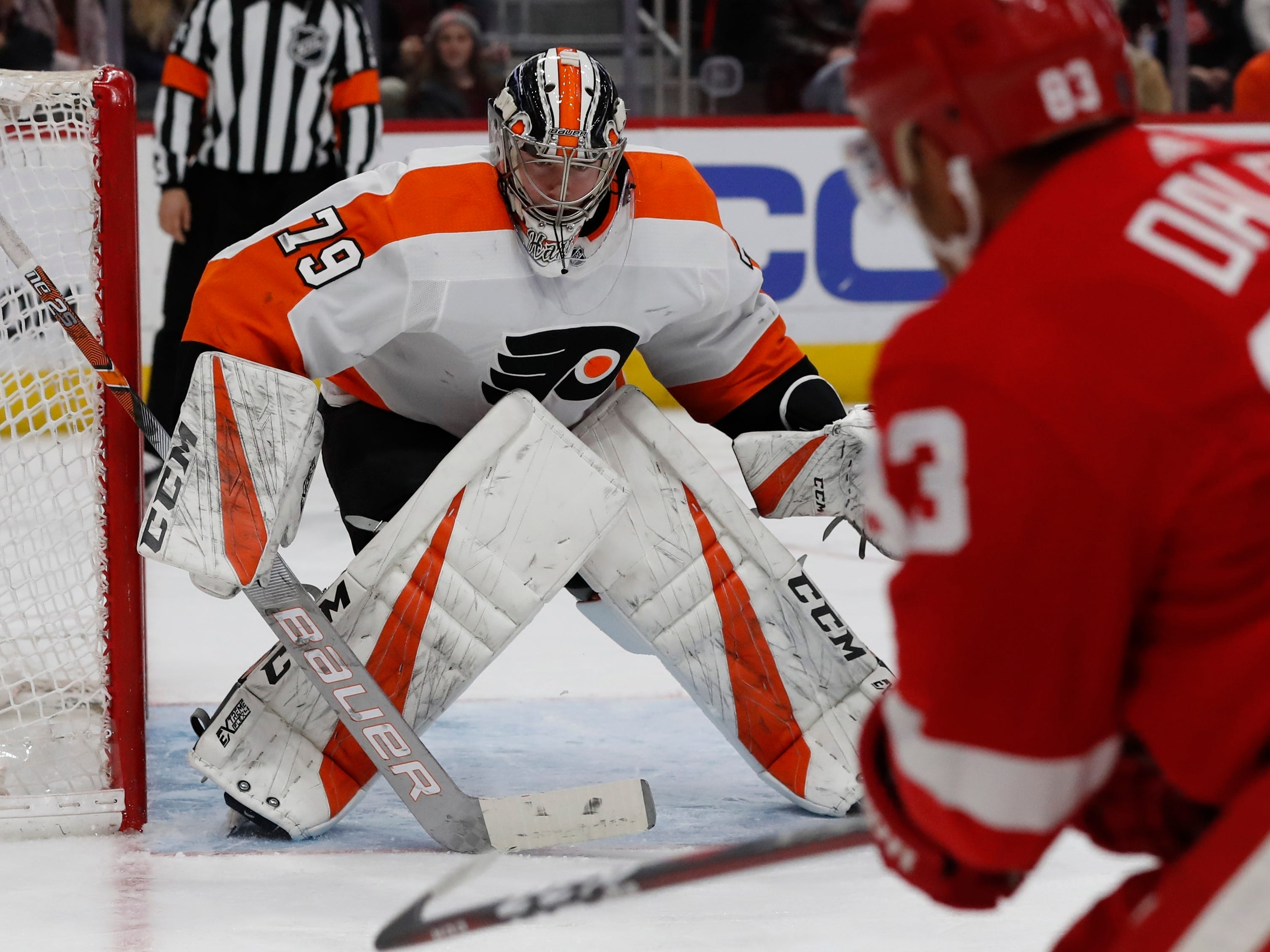 Detroit Red Wings defenseman Trevor Daley (83) shoots towards Flyers goaltender Carter Hart (79) during the second period on Feb. 17, 2019, in Detroit.