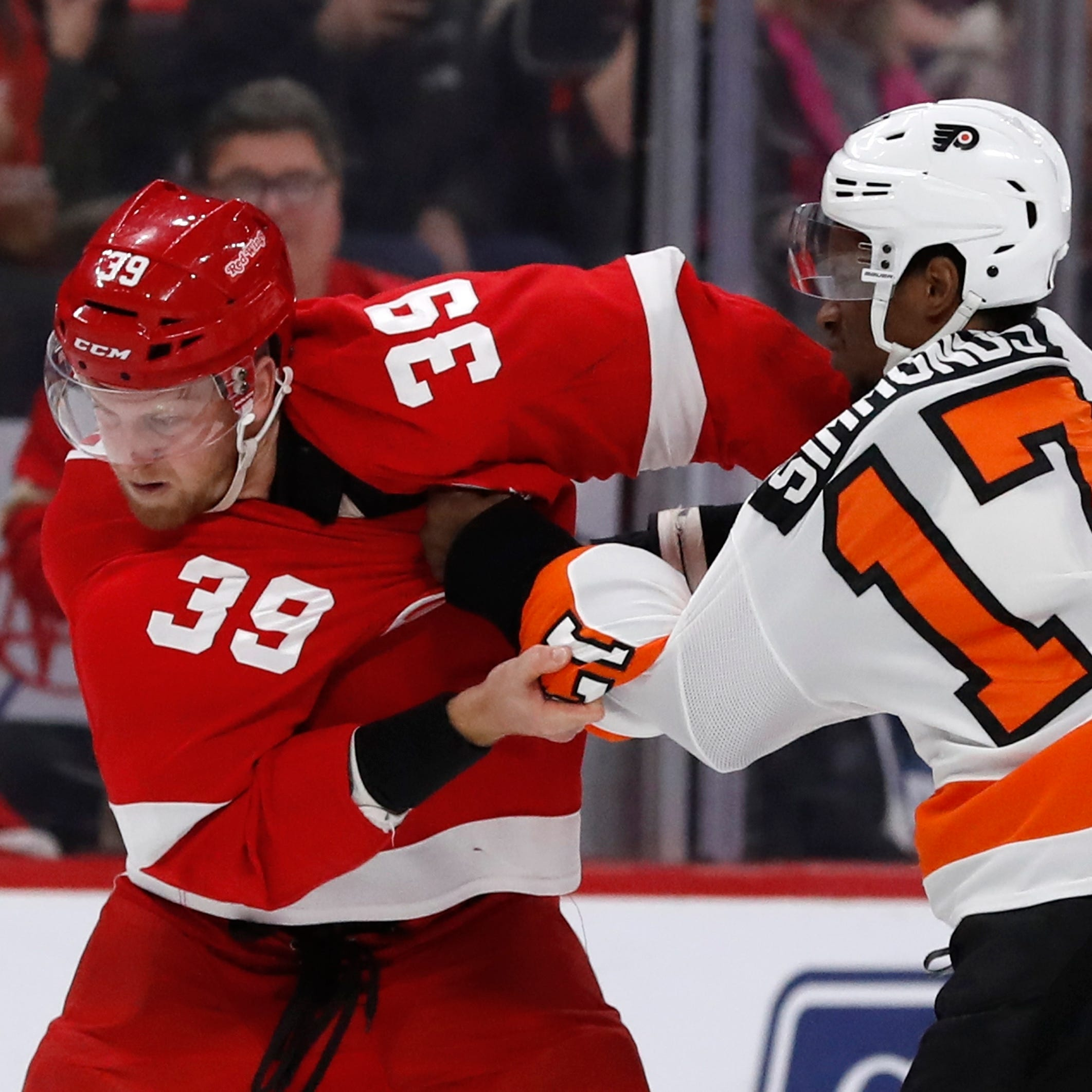 Red Wings forward Anthony Mantha (39) and Flyers...