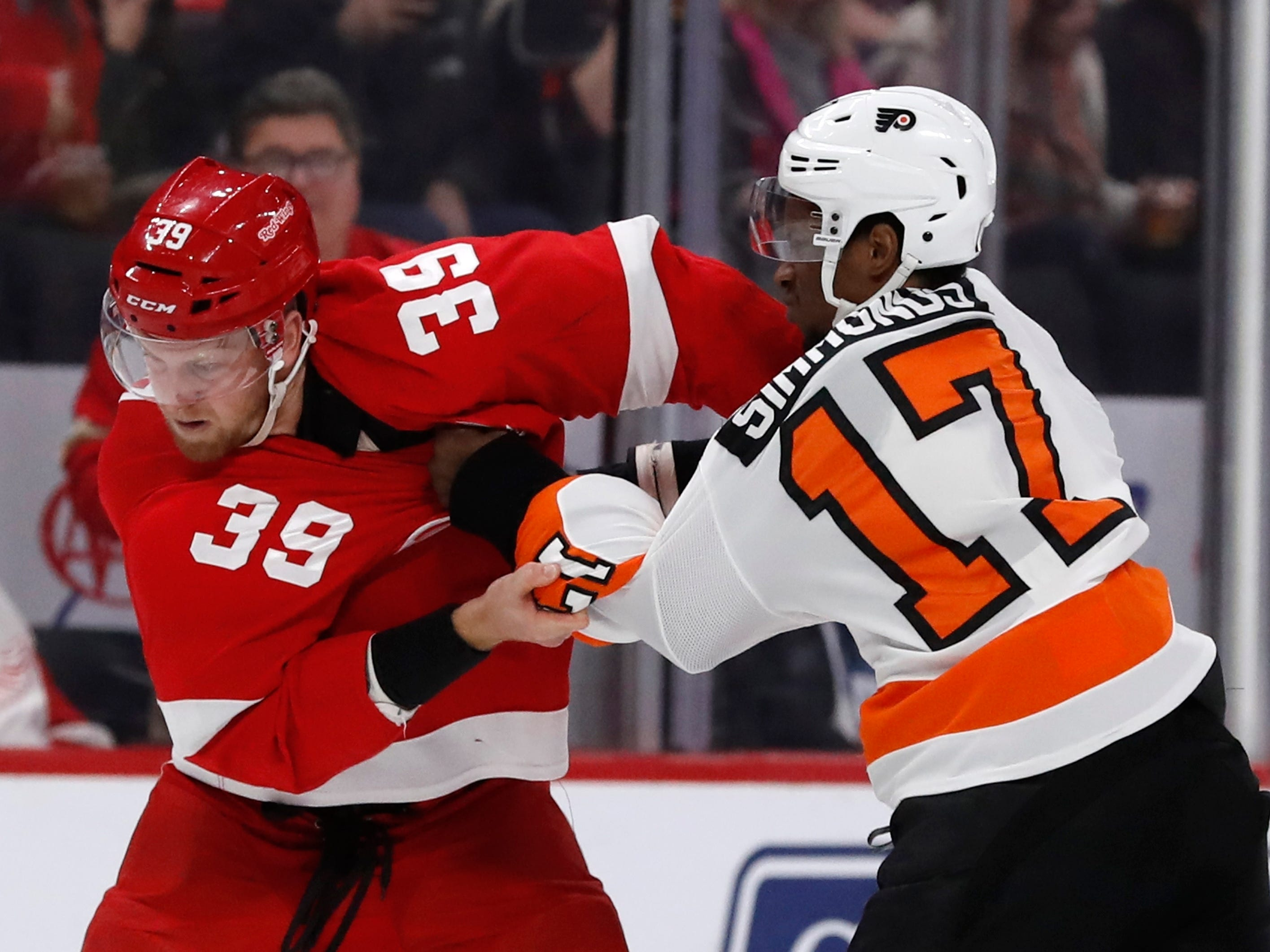 Red Wings forward Anthony Mantha (39) and Flyers forward Wayne Simmonds (17) fight during the first period on Feb. 17, 2019, in Detroit.